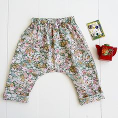 The comfort and ease of these elastic waist pants make them perfect for active babies and toddlers. They're cut slightly long so that they can be cuffed and un-
