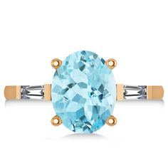 Two baguette-cut rectangular side stones flank a large oval-cut aquamarine to give this rose gold engagement ring a unique and beautiful look. Aquamarine Stone, Best Engagement Rings, Semi Precious Gemstones, Baguette, Gemstone Rings, Rose Gold, Diamond, Metal, Accessories