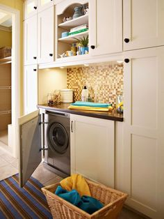Now, the rich hues of this earthy mosaic add welcoming depth and warm the space between blocks of cabinetry: http://www.bhg.com/rooms/laundry-room/makeovers/laundry-room-decorating-ideas/?socsrc=bhgpin052314mosaicmasterpiece&page=19