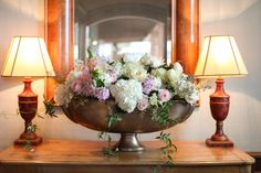 Entrance arrangement for Summer Aspen wedding by Mountain Flowers of Aspen featuring white hydrangea, pink roses, and white peonies. #aspen #wedding #hydrangea #roses #peonies