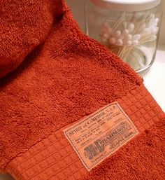 Apothecary label hand towels--this site has directions and free downloadable labels for the project.