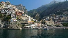 #Positano #Italy- A beautiful #Amalfi #coast #village with white Moorish houses hanging on the slope around a turquoise bay. Get some great #trip_ideas and start planning your next trip! See More: RoutePerfect.com