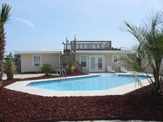 Moon Glow is a Semi-Oceanfront Sandbridge rental with 5 bedrooms and 2 bathrooms. Find amenities, availability and more regarding this Siebert Realty rental property here.