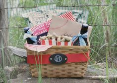 I know this basket is baseball themed... but throw in a Broadway soundtrack, a show magnet, a pair of toy binoculars, a show flyer, and a couple tickets to an upcoming musical!