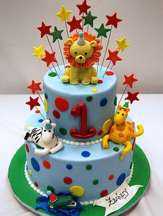 Fun Animal Birthday Cake: Let's roar! Baby animal themes are very popular to celebrate a child's first (or second) birthday party. Make your party unforgettable with a showstopping cake like this fondant embellished animal birthday cake.  Source: Pink Cake Box
