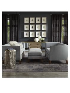 Small space sensation...Mona loveseats and matching ottoman, Fairbanks mirrored console, and our collection of minerals in sliver frames. Mitchell Gold