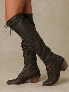 Awesome knee high black lace up boots!