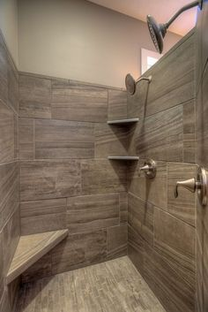 walk-in tile master shower with corner seat and corner shelves. 2 shower heads.