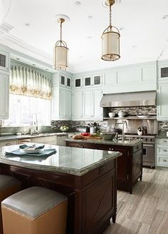 Different, but beautiful kitchen. Love the gold accents with the green.