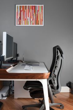 That's Some Chair:    The desk is the Airia by Herman Miller, and the chair appears to be the Embody, also by Herman Miller. The photographer also created the art that you see in the background, using reclaimed wood from various sources. The desk has a built-in cable channel, and you can see an additional cable cover below the desk to keep the floor looking neat.    Nicely done, although I'm struggling to understand how that chair works.  Via Mac Ooh Yeah.