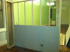 To create a quiet spot in the front of the space, we decided to build a movable wall to create some separation and provide a bit of security from prying eyes. Below are photos of the build. Room Divider Bookcase, Diy Room Divider, Diy Finish Basement, Fabric Room Dividers, Movable Walls, Studio Living, Living Room, Basement Remodeling, Basement Ideas