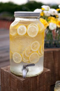 Lemon water in a mason jar drink dispenser