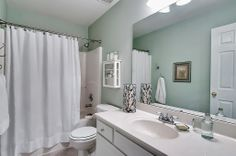 A simplified and organized bathroom! Goodbye, House. Hello, Home! Blog : Home Staging  Ideas for a Hall Bathroom Transformation