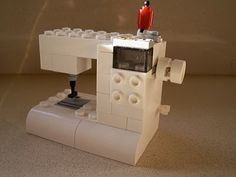 LEGO sewing machine!  Awesome!  I think one of my kiddos needs to make this for me.....