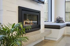 Perfect for the cooler months the fireplace sits central at the far end of the living space. Calley Homes Loft Spaces, Living Spaces, Exposed Rafters, Chimney Cap, Building Companies, Covered Decks, Bedroom With Ensuite, Guest Bedrooms, Concrete Floors