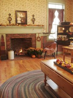 Love the Colonial fireplace and wallpaper