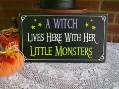 A Witch Lives Here With Her Little Monsters Halloween Sign