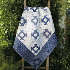 Quilt by Evelyn YoungSometimes, less is more. Evelyn Young's quilt is beautiful in its simplicity. The authentic naturally-dyed indigo fabrics from South Africa add to its beauty.