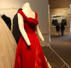 "An red velvet dress with a built-in corset and an open-backed, white  dress with black velvet trim that dates to the 1940s are part of the ""Dashing Through Time"" exhibit at  Memphis Pink Palace Museum."