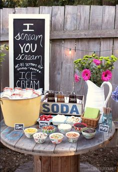 summer party ideas decorating.  items in yellow bucket are skinny cow ice cream sandwiches in personalized containers.  lots of toppings on the table.  what a cute summer party idea.