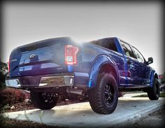 """Kentwood Kustoms """"Blue Flame Metallic"""" 2015 #Ford F-150 XLT #4x4.  Modifications include:  fender flares painted to match, Mayhem rims, Pro Comp Xtreme A/T tires.  Book your test drive today."""