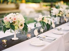White table linen, charcoal table runner, light grey napkins.