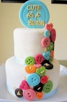 Cute idea for a kids birthday, but I would do one layer, use buttercream instead of fondant and button shaped sugar cookies instead of shaped fondant.  I'm just not a huge fan of fondant.