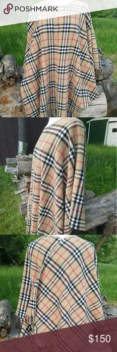 Cashemere plaid poncho It's beautiful and in good condition Cashemere. It's 30% cashemere and 70 % lambswool. It comes from smoke and pet free home. Cashemere Jackets & Coats