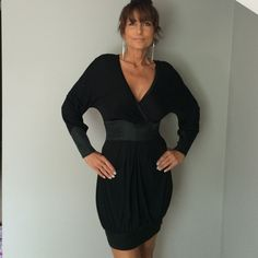 """NWT Little Black Dress Sexy NWT Bebe Dress -  deep V in front with fitted waist, cuffs and front bottom in silk - three button cuff with keyhole back - bust is 36"""" and length is 33"""" - 90% rayon and 10% wool with contrast of 96% silk, 4% spandex bebe Dresses Midi"""