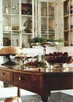 Antique wood island in a Gorgeous Kitchen with Glass doored cabinetry. I love these glass cabinets Beautiful Kitchens, Beautiful Homes, Beautiful Life, Farmhouse Kitchen Island, Rustic Kitchen, How To Antique Wood, Wooden Tables, Wooden Desk, Cottage Chic