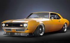 orange yellow Camaro with front spoiler