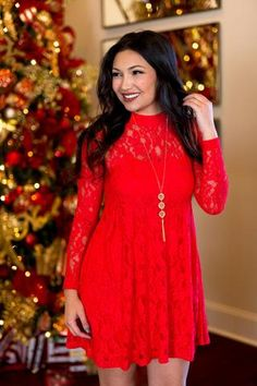 This is such a cute little red dress. I love that it is made out of lace. It is cool that the lace is thinner on the shelves. It seems like this would be a great dress for the holidays.