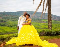 Image may contain: 2 people, people standing, outdoor and nature African Bridal Dress, African Wedding Attire, African Attire, African Dress, Venda Traditional Attire, Traditional Gowns, African Traditional Wedding Dress, Traditional Wedding Attire, Yellow Wedding Dress
