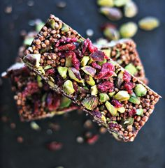 Quinoa Coconut-Cacao Bar  melt together: 6 Tbsp coconut oil, 2 Tbsp coconut butter, 4 heaping Tbsp of raw cacao powder, 2 tbsp of maple syrup, pinch of salt. Stir in 1 cup Puffed Quinoa Cereal 1/4 cup Cranberries 1/4 cup pistachios then pour into a lined loaf pan and chill until set.