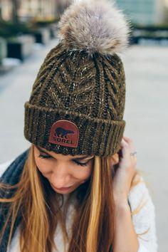 sorel hat, pom pom beanie — via @TheFoxandShe