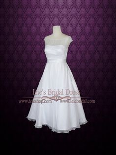 Dress Info Ordering at Ieie's Custom Designs Beautiful simple feminine vintage style retro 50s white tea length wedding dress with modest neckline, cap sleeves, and silver sash. Created with soft sheer chiffon. Back can be made with zipper or buttons if desired. This dress can also be customized in other colors. Working Time: 8-10 weeks Rush Order please inquire prior to order. Ordering Your Wedding Dress at Ieie's Dress We understand how difficult it is to purchase a wedding dress online…