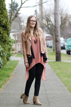 Leather jacket, peach dress, leggings, and a chevron necklace