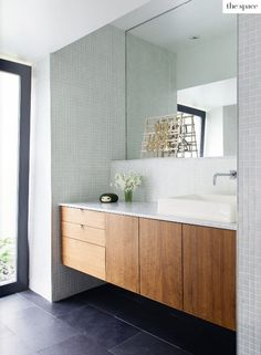 floating cabinet; tiled mirror wall. Not crazy about the actual tile.