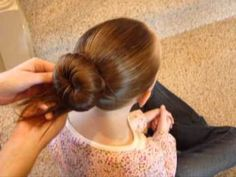 "How to make the perfect #BalletBun:   We call this a ""Ballerina Bun"" or a ""Ballet Bun"" at our house. I've also heard these buns called #Dance Buns, Sock Buns, Donut Buns, Bun Molds, a Chignon, and Figure Skating Buns. I know some people make these with a rolled up sock (hence the name ""sock bun"") or even with a large scrunchie as a foundation. #DanceBuns"