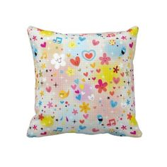 Fun cartoon pattern throw pillow with colorful cute hearts, flowers, stars and music notes.