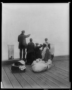 NYC. Four Immigrants and Their Belongings at Ellis Island, circa 1912 //   Prints & Photographs Division of the Library of Congress