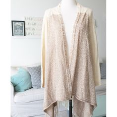 """Oatmeal Fringed Duster Open Cardigan This adorable and soft woven cardigan is so cute and cozy, but I just don't have the height to pull it off. I'm 5'3"""" and the fringe falls around me ankle area. Purchased at Nordstrom last winter. Love By Design Sweaters"""