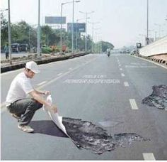 fake pot holes to slow people down