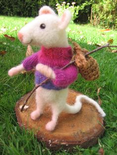 This funny little white mouse was handmade by me and is made of 100% wool. He is determined to see the whole world. In his knapsack he has a little
