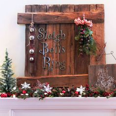 Country-Theme Christmas Mantel - love the graphic detail! More mantel ideas: http://www.bhg.com/christmas/indoor-decorating/real-home-christmas-mantel-decorating/