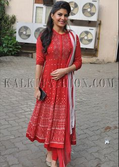 Jacqueline Fernandez [Jacqueline Fernandez was spotted at the Mehboob Studio in Mumbai on Thursday. The actress looked pretty in a red and white anarkali suit. Jacqueline's 'Kick' will hit the theatres tomorrow. Pakistani Dresses, Indian Dresses, Indian Outfits, Kurti Designs Party Wear, Salwar Designs, Blouse Designs, Indian Attire, Indian Ethnic Wear, Leighton Marissa Meester