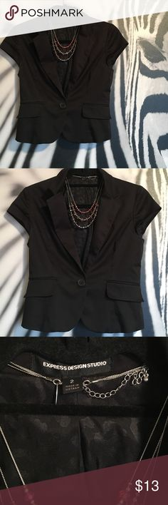 Express sleeveless blazer with free necklace Express Sleeveless blazer. Size 2. Includes NY&C beaded necklace. Blazer in preloved condition with no tears or odors. Cute animal print interior lining. 99% cotton/1% spandex for just a touch of stretch. Very flattering and cute for work! Express Jackets & Coats Blazers