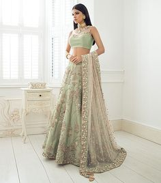 Elegant mint bridal lengha detailed with pretty lanterns and hints of floral lemon flowers throughout. This bridal has been feature with a simple crop top with mesh and a heavy contrasting baby pink dupatta. Asian Bridal Dresses, Asian Wedding Dress, Indian Bridal Outfits, Indian Gowns Dresses, Pakistani Outfits, Desi Wedding Dresses, Wedding Wear, Indian Wedding Gowns, Wedding Lenghas
