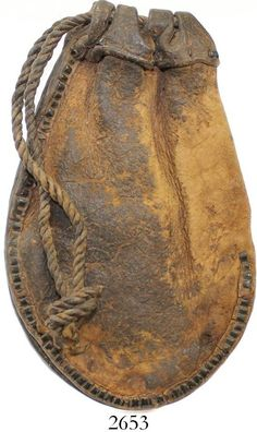 """Small leather money pouch (1600s?) found in Seville harbor. 543 grams, 5-3/4"""" x 3-1/2"""". Fully intact, even the drawstring at the opening, but stiff and flat and (apparently) empty, just a neat antique from Spain, with x-ray showing contents (or lack thereof) inside."""