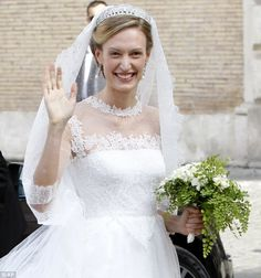 7/5/14.  Elegant: Elisabetta Maria Rosboch von Wolkenstein beams as she arrives for her wedding with Belgium's Prince Amedeo in Rome. The couple were dating for seven years before they got engaged